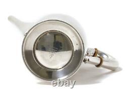 Sterling silver tea pot. USA, workshop International Silver Co